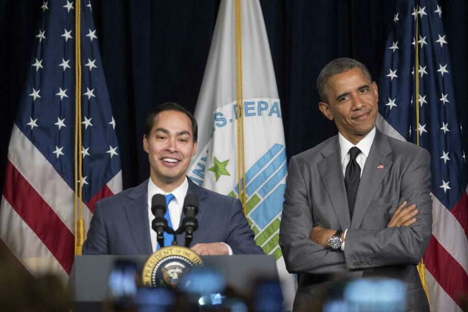 President Barack Obama, right, gestures to Julian Castro, secretary of U.S. Housing and Urban Development (HUD), as they arrive to speak at the Department of Housing and Urban Development on July 31, 2014 in Washington, D.C. Castro, the former San Antonio, Texas mayor, was sworn in this week and will begin his duties on Monday, Aug. 4. (Photo by Andrew Harrer-Pool/Getty Images) Photo: Pool, Pool / Getty Images / 2014 Getty Images