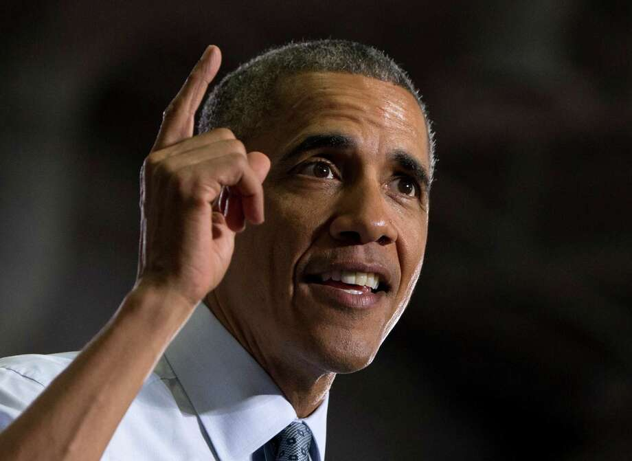 Drawing sharp contrasts to Republicans, a confident President Barack Obama outlines an ambitious agenda during a speech at the University of Wisconsin at La Crosse. Photo: Carolyn Kaster /Associated Press / AP