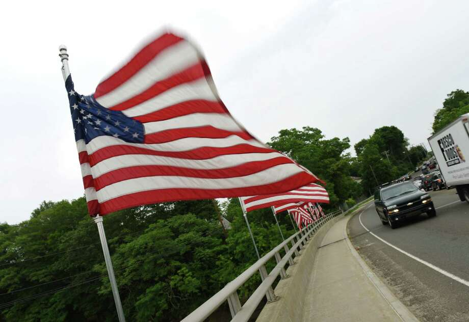 American flags blow in the wind as traffic passes over the Route 1 Mianus River Bridge in Greenwich, Conn. Thursday, July 2, 2015. Photo: Tyler Sizemore / Hearst Connecticut Media / Greenwich Time