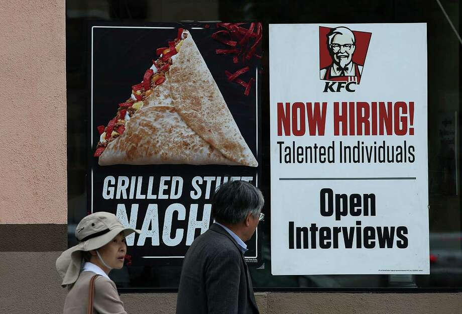 "Pedestrians walk by a ""now hiring"" sign at a KFC restaurant on July 2, 2015 in San Francisco, California. According to a report by the U.S. Labor Department, employers added 223,000 jobs in June dropping the national unemployment rate to 5.3 percent, the lowest level since April 2008.  (Photo by Justin Sullivan/Getty Images) Photo: Justin Sullivan, Staff / Getty Images / 2015 Getty Images"