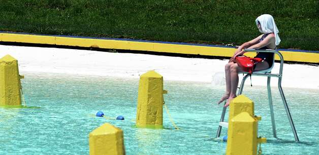 A lifeguard uses a T-shirt to keep cool at the Lincoln Park Pool Thursday afternoon, July 2, 2015, in Albany, N.Y.   (Skip Dickstein/Times Union) Photo: SKIP DICKSTEIN