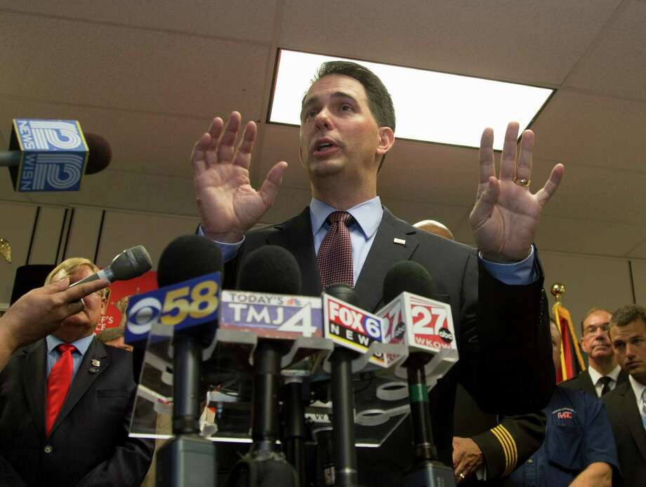 Wisconsin Gov. Scott Walker survived a recall election in 2012 after clashing with Democrats and union leaders. Photo: Associated Press File Photo / FR59249 AP