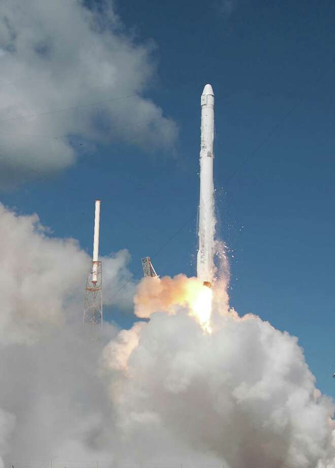 The SpaceX Falcon 9 rocket and Dragon spacecraft lifts off from Space Launch Complex 40 at the Cape Canaveral Air Force Station in Cape Canaveral, Fla., Sunday, June 28, 2015. The rocket carrying supplies to the International Space Station broke apart shortly after liftoff. (AP Photo/John Raoux) Photo: John Raoux, STF / AP