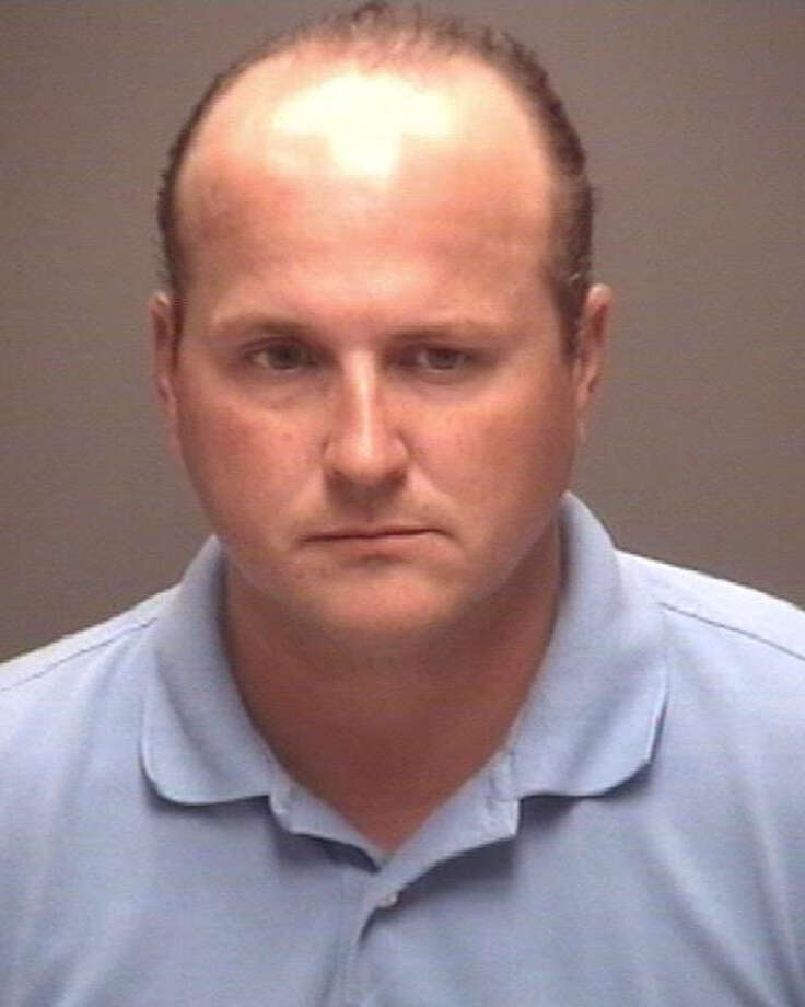 Former Galveston County Court-at-Law Judge Christopher Dupuy was arrested in Galveston on July 2, 2015 and charged with two counts of online harassment. / handout