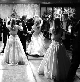 Dads dance with their daughters at the 51st CPMC Debutante Ball at the St. Francis Hotel. June 2015