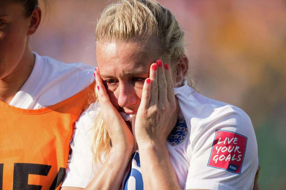 England's Laura Bassett weeps after she scored an own-goal in the waning moments of the game to give Japan the win in their semifinal match. Photo: GEOFF ROBINS, Stringer / AFP