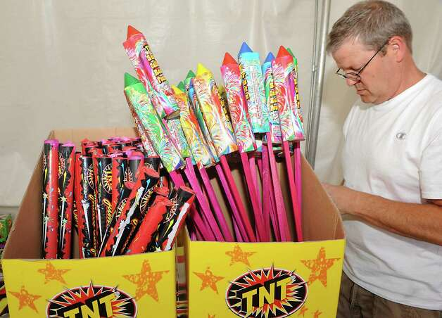 Kevin Keller of Pennsylvania sets up a fireworks display in a TNT Fireworks tent in the parking lot at Mohawk Commons on Thursday, July 2, 2015 in Niskayuna, N.Y. Kevin wanted to spend some time with his son who was working there. (Lori Van Buren / Times Union) Photo: Lori Van Buren / 00032452A