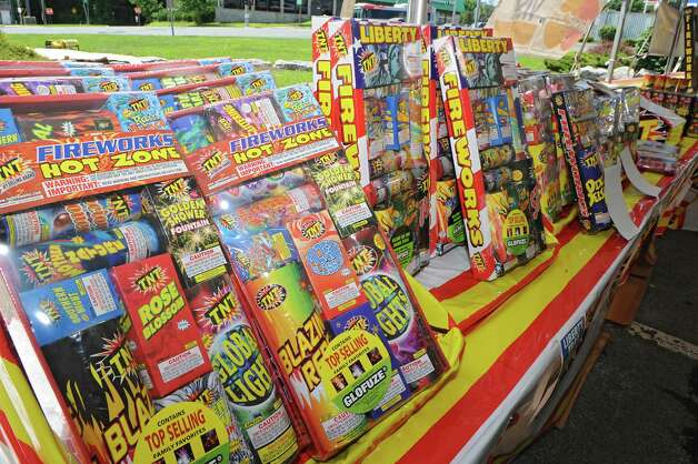 Packages of fireworks are displayed in a TNT Fireworks tent in the parking lot at Mohawk Commons on Thursday, July 2, 2015 in Niskayuna, N.Y. (Lori Van Buren / Times Union) Photo: Lori Van Buren / 00032452A