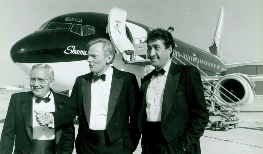 Mayor Henry Cisneros with SeaWorld CEO George Becker and Southwest Airlines Chairman Herb Kelleher are shown during the inaugural season for San Antonio's SeaWorld park on May 23, 1988. Photo: Express-News File Photo / San Antonio Express-News