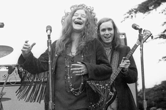 Top: Young people play with a giant ball in Golden Gate Park at the dawn of the Summer of Love on June 21, 1967. Above: Janis Joplin, who along with the Grateful Dead and Jefferson Airplane is considered an architect of the San Francisco Sound, jams with her band around 1970.