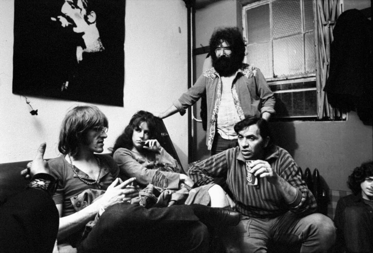 Bill Graham (right), owner of Fillmores East & West, chats with Paul Kantner (left) and Grace Slick of Jefferson Airplane and Jerry Garcia of the Grateful Dead.