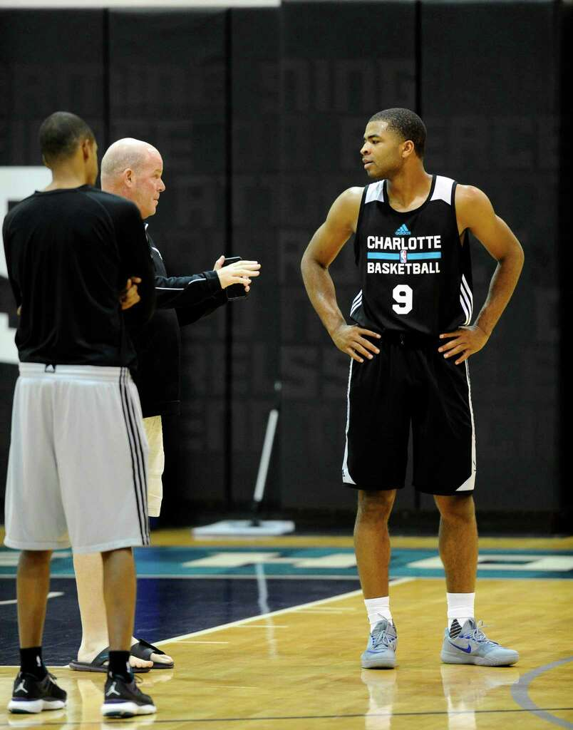 essay scorer harrison aaron harrison right talks hornets coach steve clifford after wednesday s opening practice for