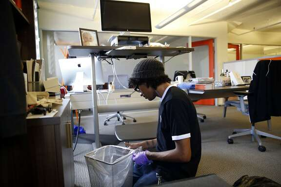 Managed by Q's Jai Martinez cleans at the offices of Homebrew in San Francisco, Calif., on Thursday, July 2, 2015.