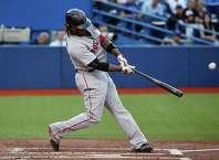 TORONTO, CANADA - JULY 2:  Hanley Ramirez #13 of the Boston Red Sox hits a solo home run in the first inning during MLB game action against the Toronto Blue Jays on July 2, 2015 at Rogers Centre in Toronto, Ontario, Canada. (Photo by Tom Szczerbowski/Getty Images) ORG XMIT: 538585743
