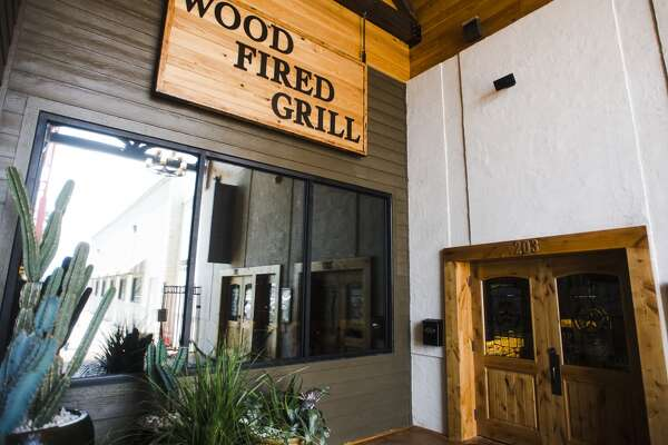A large sign hangs above the door to Jerry Nelson's Hill Country Wood Fired Grill on Wednesday afternoon. The grill is a new restaurant attached to the front of Jerry Nelson's Hill Country Backyard Music Hall, and is the focus of the cat5 Restaurant of the Week for July 2, 2015. Photo taken Wednesday 6/24/15 Jake Daniels/The Enterprise
