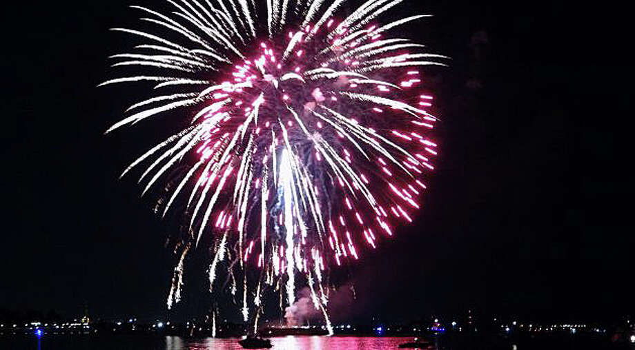 Fairfield's Independence Day fireworks celebration has been moved this year to Friday, July 3. The pyrotechnics light up the skies over Jennings and Penfield beaches at dusk. Photo: File Photo / File Photo / Fairfield Citizen