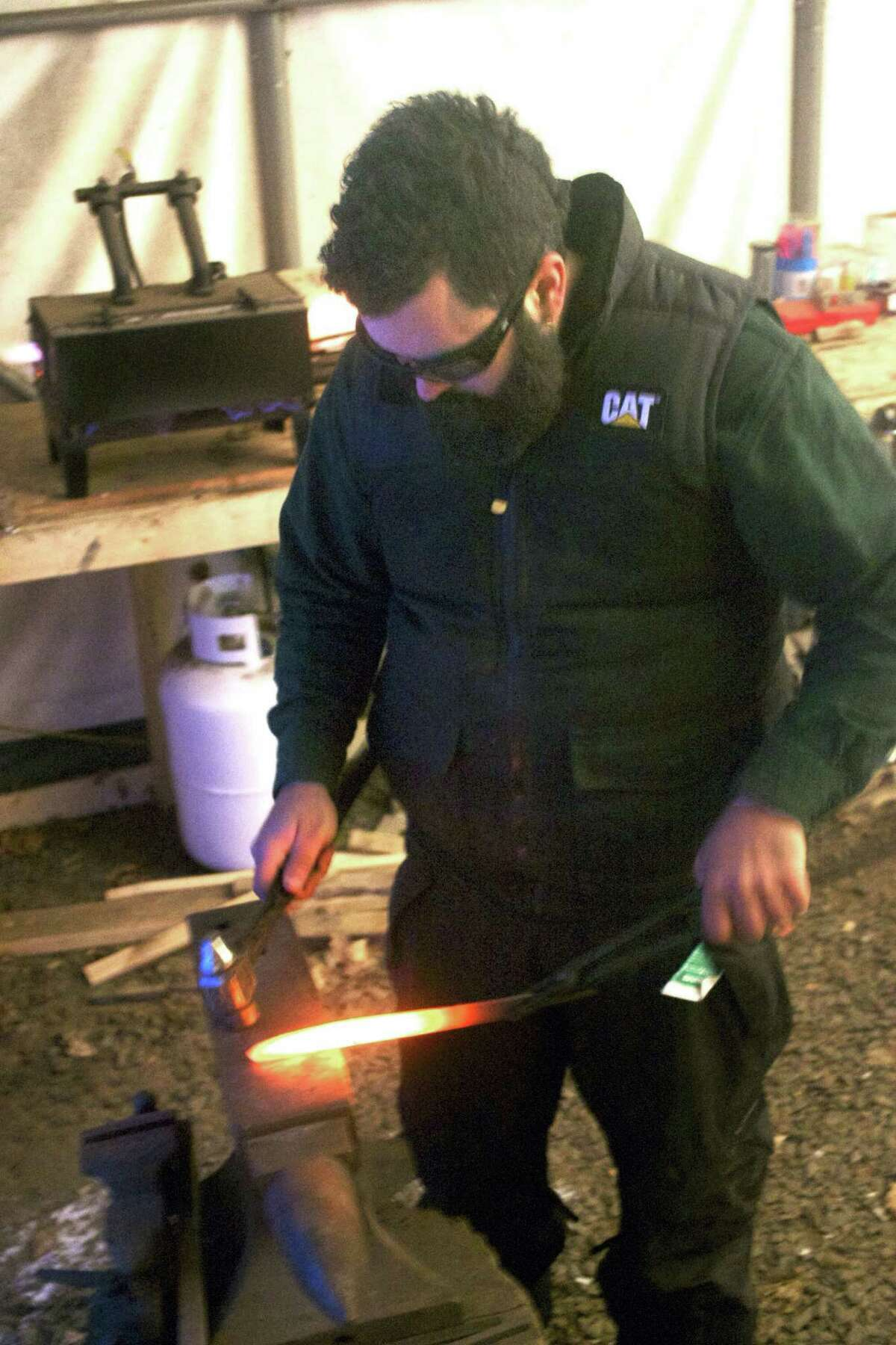 Jamie Vining works with a blade and anvil in his Danbury blacksmith shop, much as he will in the July 20 episode of Forged in Fire on The History Channel.