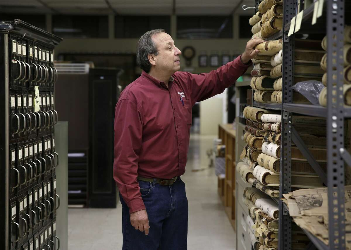Jay Thompson, an employee at the Shasta Historical Society, poses for a portrait in the society's archives in Redding, CA, on Thursday, July 2, 2015. Scientists have blamed historic gold mining for some of the mercury pollution in Lake Shasta.