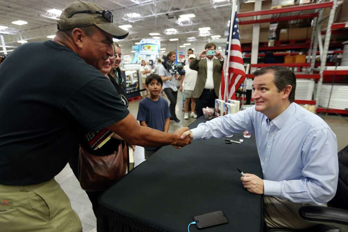 Eric Medearis and his family meet presidential candidate Sen. Ted Cruz during a book signing Wednesday at a Houston Sam's Club. ( Mayra Beltran / Houston Chronicle )