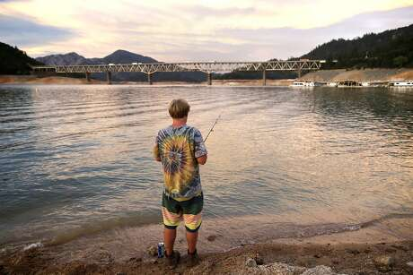 Danny Keen of Big Bend, CA, fishes from the shore of Lake Shasta, CA, on Wednesday, July 1, 2015. Mercury levels in bass and catfish in Lake Shasta may be higher than reported in state fishing guidelines, posing a threat to human health. Photo: Terray Sylvester, The Chronicle