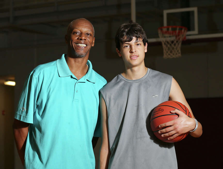 """Portrait of former UTSA and professional basketball player Derrick Gervin (left), younger brother of former Spurs player George """"The Iceman"""" Gervin, and O'Connor High School junior Jake Gleinser, 15, on June 22, 2015 at the George Gervin Academy. Photo: Edward A. Ornelas /San Antonio Express-News / © 2015 San Antonio Express-News"""