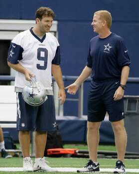 Dallas Cowboys quarterback Tony Romo (9) chats with head coach Jason Garrett during minicamp at the team's stadium in Arlington on June 18, 2015. Photo: LM Otero /Associated Press / AP
