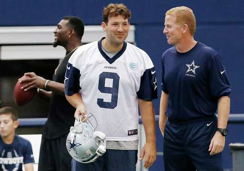 Dallas Cowboys quarterback Tony Romo and head coach Jason Garrett, talk on the sidelines as wide receiver Dez Bryant plays catch with a child during practice in Arlington on June 18, 2015. Photo: Brandon Wade /Fort Worth Star-Telegram / Fort Worth Star-Telegram