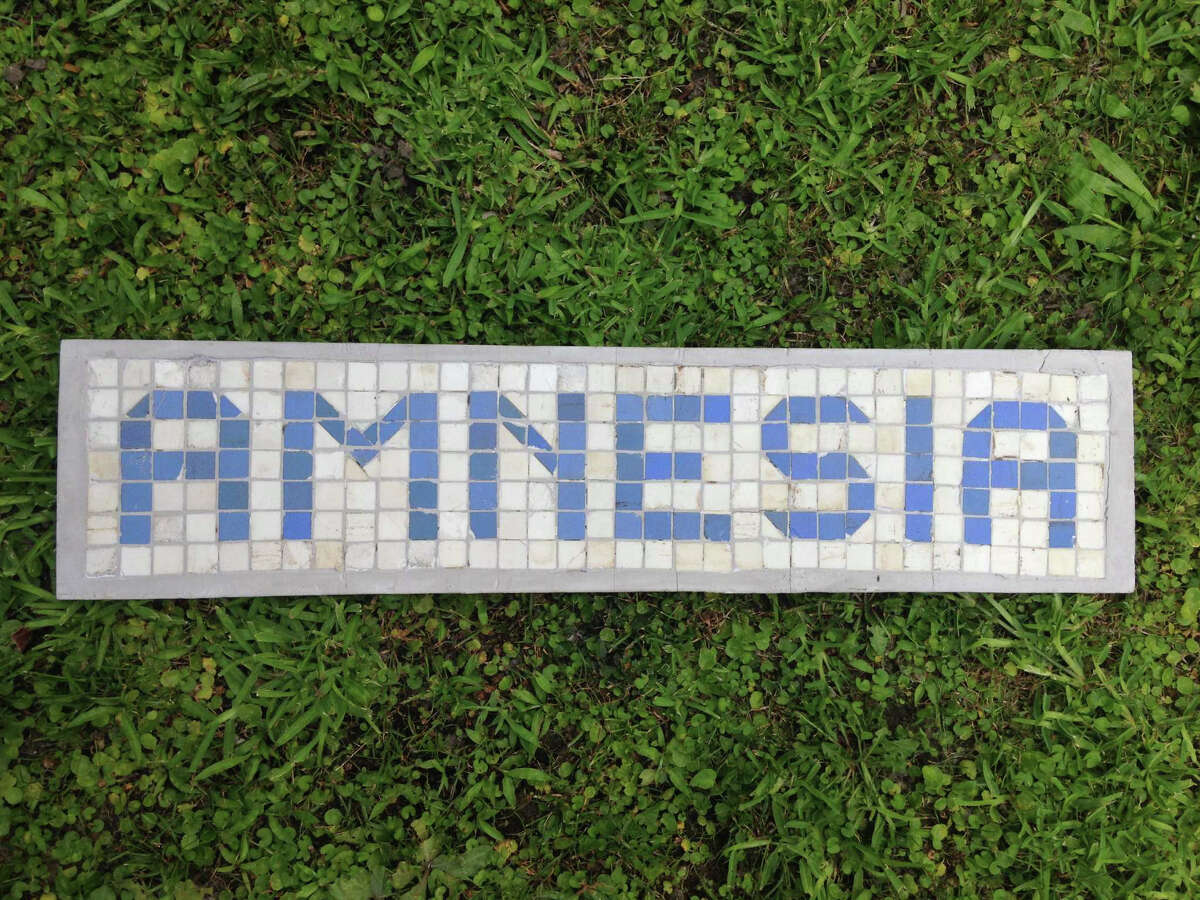 Amnesia, by James Glassman, aka the Houstorian. The piece uses blue and white tiles from Houston's old curbs.