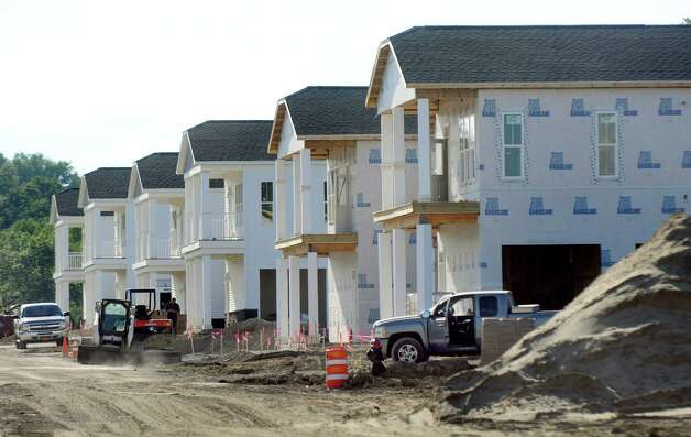 Apartment buildings under construction by RBC Construction with Capital District Properties on Friday, June 26, 2015, at The Residences at Lexington Hills in Cohoes, N.Y. (Cindy Schultz / Times Union) Photo: Cindy Schultz / 00032408A