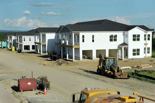 Apartment buildings under construction on Friday, June 26, 2015, at The Residences at Lexington Hills in Cohoes, N.Y. (Cindy Schultz / Times Union) Photo: Cindy Schultz / 00032408A