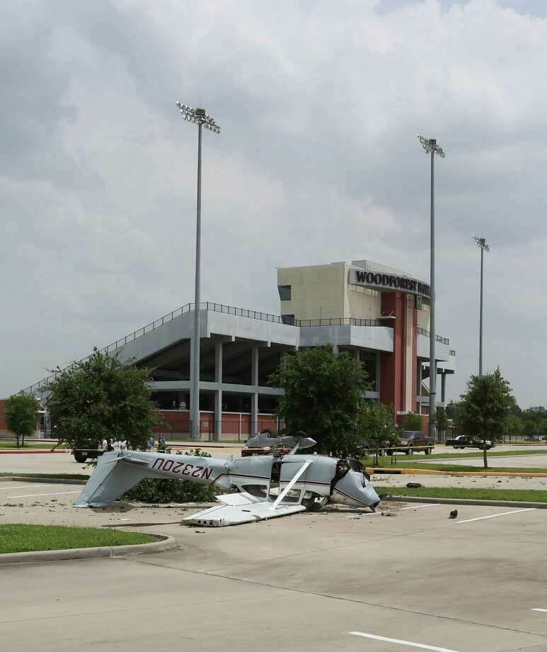 Investigators from the FAA and State Troopers work the scene of a single-engine plane crash at Woodforest Bank Stadium in the 19000 block of David Memorial Dr. Friday, July 3, 2015, in Shenandoah. Photo: Jon Shapley, Houston Chronicle / © 2015 Houston Chronicle