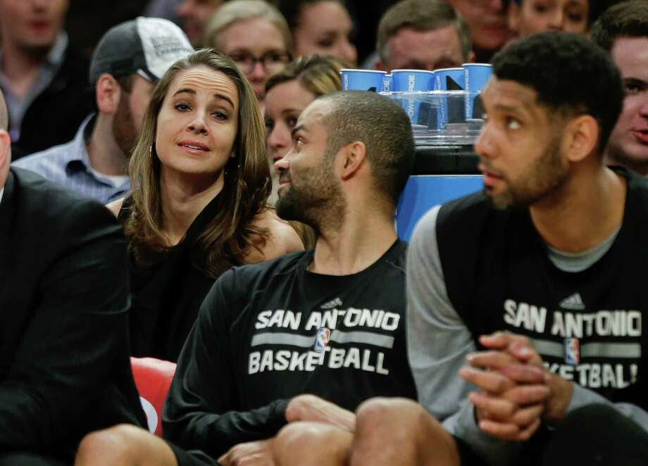 San Antonio Spurs assistant coach Becky Hammon, left, talks with Tony Parker, center, as Tim Duncan, right, looks away during the first half of an NBA basketball game Tuesday, March 17, 2015, in New York. Photo: Frank Franklin II /Associated Press / AP