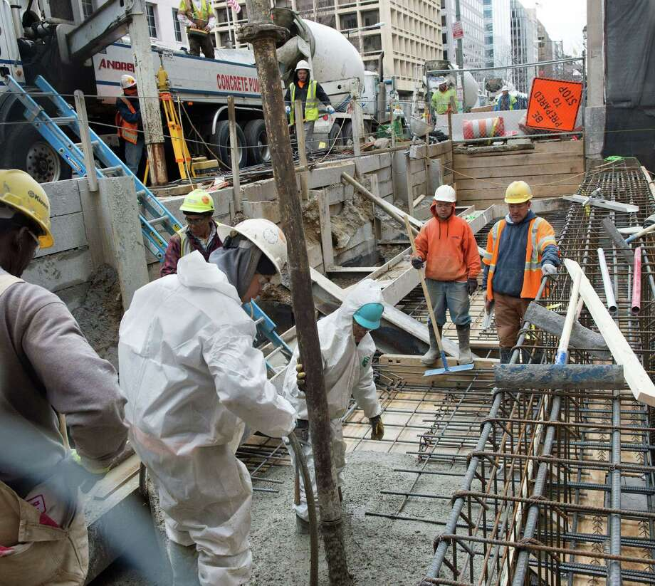 Construction workers pour concrete for a new building in Washington, D.C. One expert says more Americans can return to the workforce without generating much inflation. Photo: Paul J. Richards /AFP / Getty Images / AFP