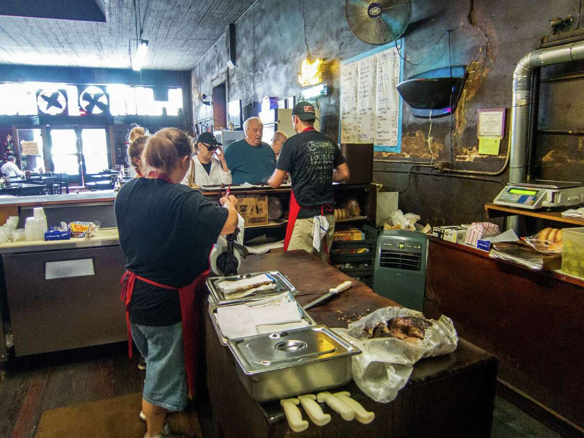 Patrons order at the counter at Louie Mueller Barbecue in Taylor, Texas.