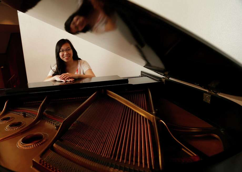 Esther Liao, an award winning pianist, photographed in the lobby of Jones Hall on Thursday, July 2, 2015, in Houston.  ( Karen Warren / Houston Chronicle ) Photo: Karen Warren, Staff / © 2015 Houston Chronicle