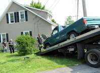 H and K Towing removes a pickup truck involved in a two-vehicle crash into 3801 Albany St. on Friday, July 3, 2015, in Niskayuna, N.Y. (Cindy Schultz / Times Union)
