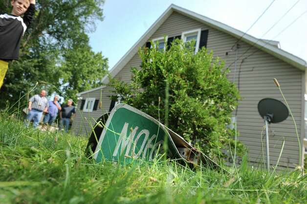 The street signs for Mohroff Avenue lies in the yard of 3801 Albany St. after a two-vehicle crash on Friday, July 3, 2015, in Niskayuna, N.Y. (Cindy Schultz / Times Union) Photo: Cindy Schultz