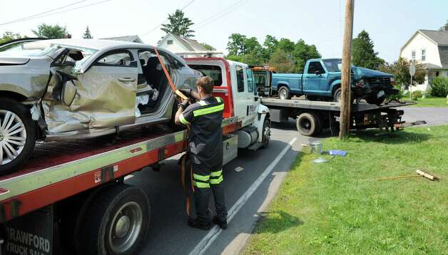 H and K Towing works to remove two vehicles involved in a crash at 3801 Albany St. on Friday, July 3, 2015, in Niskayuna, N.Y. (Cindy Schultz / Times Union) Photo: Cindy Schultz
