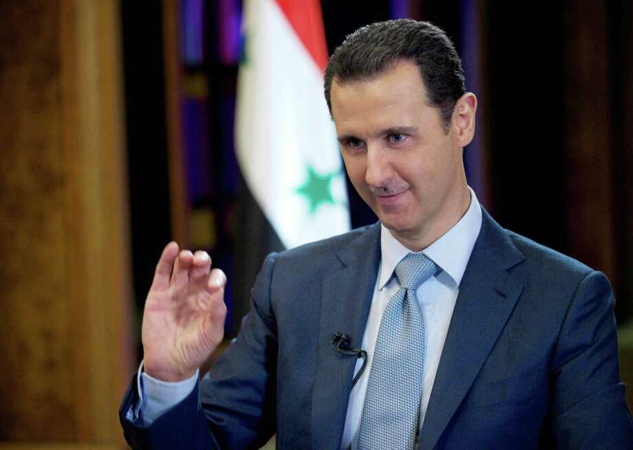 FILE - In this Tuesday, Feb. 10, 2015 file photo released by the Syrian official news agency SANA, Syrian President Bashar Assad gestures during an interview with the BBC, in Damascus, Syria. (AP Photo/SANA, File) Photo: HOPD / SANA