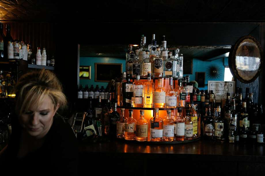 The comfortable Hotsy Totsy Club in Albany is like visiting a friend — a friend with a lit-up tower of 60 or so gins. Photo: Loren Elliott, The Chronicle