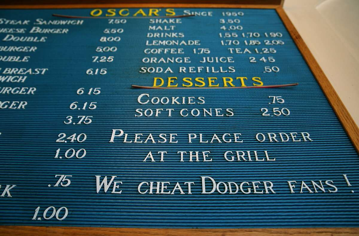 The menu on the wall at Oscar's includes a playful message for Dodger fans in Berkeley, Calif. on Friday, July 3, 2015. Located just a few blocks south of the Gourmet Ghetto, the popular hamburger joint that has been serving charbroiled burgers and french fries since 1950 is shutting down at the end of the summer, according to the owner.