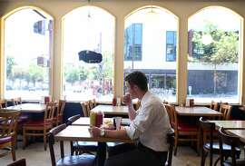 Andrew Hoffman enjoys his lunch at Oscar's in Berkeley, Calif. on Friday, July 3, 2015, where he says he eats about once a week. Located just a few blocks south of the Gourmet Ghetto, the popular hamburger joint that has been serving charbroiled burgers and french fries since 1950 is shutting down at the end of the summer, according to the owner.