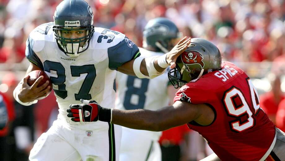 Halfback: Shaun AlexanderYears with Seahawks: 2000-2006 Seahawks stats: 2,176 rushing attempts, 9,429 yards (4.3 ypa), 100 touchdowns; 214 receptions, 1,511 yards, 12 touchdowns Career stats: 2,187 rushing attempts, 9,453 yards (4.3 ypa), 100 touchdowns; 215 receptions, 1,520 yards (7.1 ypc), 12 touchdownsThe case for: The franchise's all-time leading rusher -- and it's not close -- Alexander put together one of the greatest seasons in NFL history in 2005, when he ran for 1,880 yards and a then-record 27 touchdowns. That was Alexander's fifth-straight season with at least 1,175 yards and 14 touchdowns. Photo: Scott Eklund, Seattle P-I