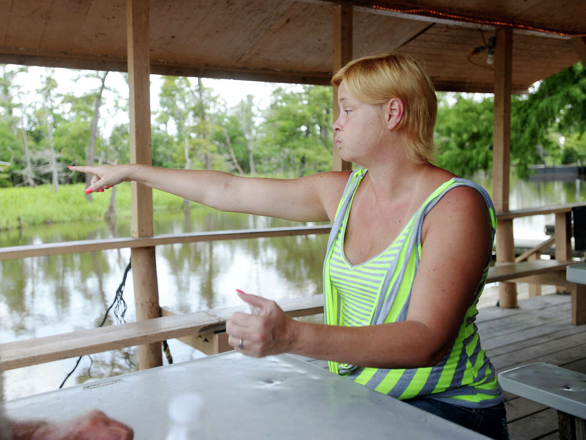 Michelle Wright describes seeing the body of Tommie Woodward after he was attacked by an alligator early Friday morning. Woodward, 28, was attacked and killed by an alligator while swimming in Adams Bayou at Burkart's Marina early Friday morning. The incident was the first fatal attack by an alligator in Texas in about 200 years. Photo taken Friday 7/3/15 Jake Daniels/The Enterprise