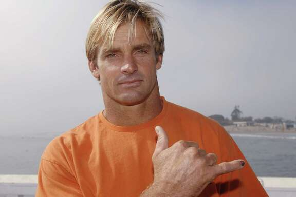 Surfer and event host  Laird Hamilton attends the 'A Day at the Beach Paddle Out Protest' held to show opposition to the nearby construction of a proposed liquid natural gas (LNG) facility in Malibu, California October 22, 2006. REUTERS/Phil McCarten (UNITED STATES)