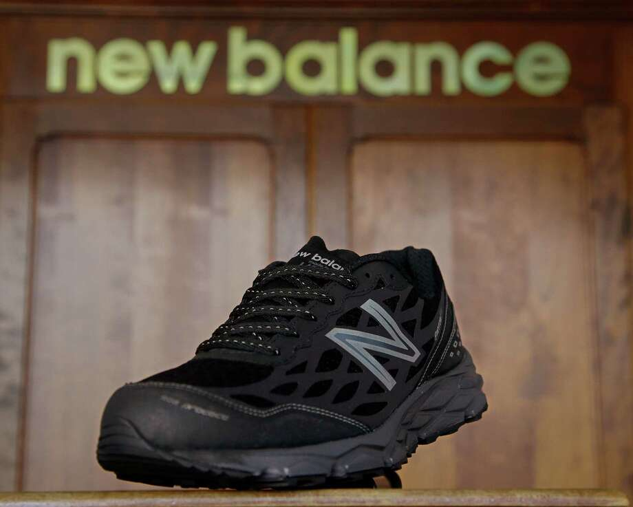 In this photo taken Wednesday, July 1, 2015, the New Balance proposed 950v2 sneaker, that has passed military testing, is displayed at one of company's manufacturing facilities in Boston. New Balance is pressing the Pentagon to buy American-made footwear for the troops instead of sneakers from rival Nike that are made in China. (AP Photo/Stephan Savoia) Photo: Stephan Savoia, STF / AP