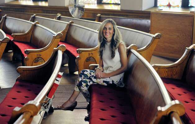 Cailin O'Meara Rabideau, a member of the 1st Baptist Church and director of the Vacation Bible School, poses for a photograph in the sanctuary on Thursday, July 2, 2015, in Ballston Spa, N.Y.   (Paul Buckowski / Times Union) Photo: PAUL BUCKOWSKI / 00032455A