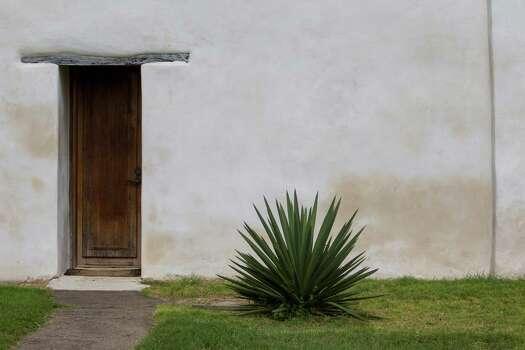 A door of the church at Mission San Juan Capistrano in San Antonio, Texas. Ray Whitehouse / San Antonio Express-News Photo: Ray Whitehouse, Staff / San Antonio Express-News / 2015 San Antonio Express-News