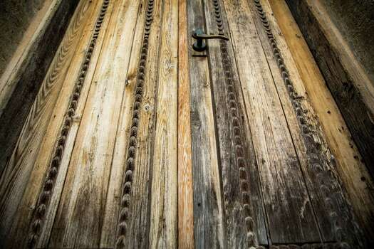 The door to the church entrance at Mission San Juan Capistrano in San Antonio, Texas has patterns on it. Ray Whitehouse / San Antonio Express-News Photo: Ray Whitehouse, Staff / San Antonio Express-News / 2015 San Antonio Express-News