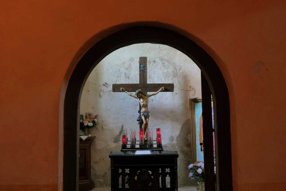 A crucifix adorns a small room in Mission Nuestra Señora de la Purisima Concepción de Acuña, known simply as Mission Concepcion.  Photo: Billy Calzada, Staff / San Antonio Express-News / San Antonio Express-News